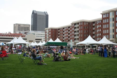 """Locals gather for """"Green Columbus Earth Day"""" at outdoor events space."""