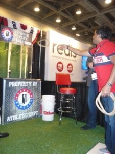 a-line-of-traffic-at-interrels-baseball-themed-booth-featuring-spin-and-win-and-the-triple-play-challenge-ring-toss-375x500