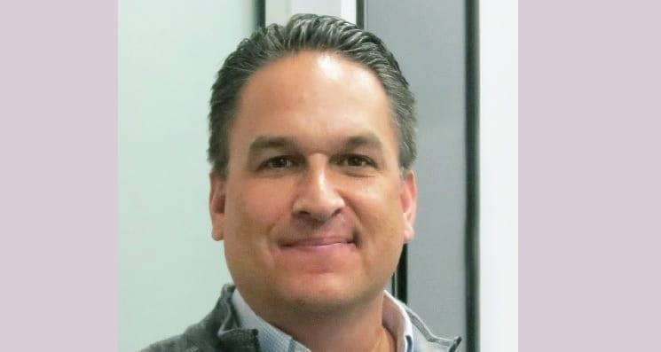 John Larson Joins ADEX International